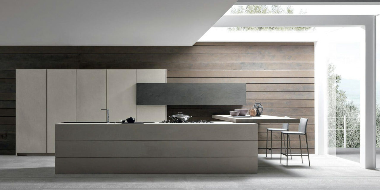 Modern kitchen by Modulnova with grey and brown tones.